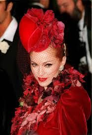 madonna evita premier- Stephen jones hat, Givenchy. I dyed the petals deepest red and stained my hands till eventually my pee turned crimson!