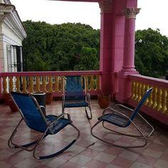 3 blue rocking chairs . #chair #rockingchair #havana #cuba #veranda #peptobismolpink by badbookns
