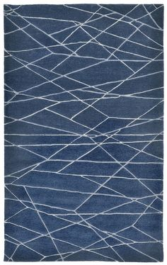 This rug features bold color blending with a contemporary design making this rug a real statement piece. Thick 100% Indian Wool is Hand Tufted by Artisans to create these rich Indoor rugs. Cut and loop construction with multiple yarn types and varying pile heights maximizes texture and creates for a dynamic artful design. #IndoorRugs