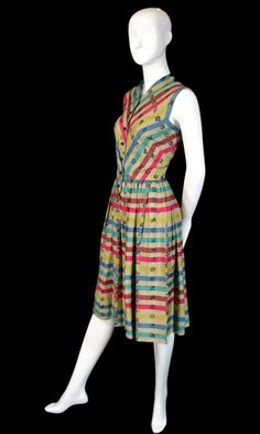 Vintage Designer  Claire McCardell Silk Dress    Vintage 1950's Claire McCardell Townley Striped Silk Dress with stamped designs and buttoned front. This dress, is a beautiful representation of Claire McCardell's talent. One of the most famous of the American Mid Century female clothing designers, she knew how to combine beautiful designs with comfort. This dress is in excellent condition and is from an incredible estate of vintage clothing. Mint condition.