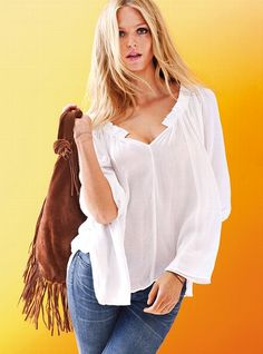 BlouseDivinely drapey viscose gauze. Easy to pack. Breezy to wear. This gauze gets around. Smocked top. Hole at chest. Elastic sleeve hem. Imported viscose gauze.     $49.50  #280-913