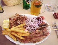My first meal in Kos~ a HUGE mixed grill with chips, salad and a brewski.......Kos, Greece 2011