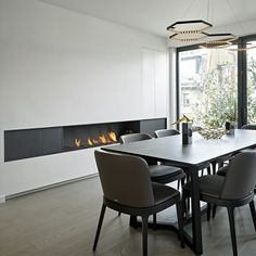 This extended raised wall fireplace with long surround panels cleverly hides a cupboard by the window, providing the perfect storage solution for this city home. Wall Fireplaces, Modern Fireplace, Fireplace Wall, Modern Luxury, Modern Contemporary, Hidden Storage, Storage Solutions, Wall Design, Cupboard