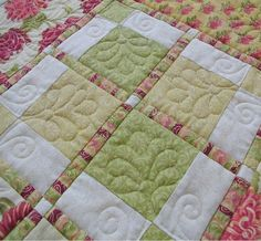 free motion quilting...like the quilt pieced pattern too