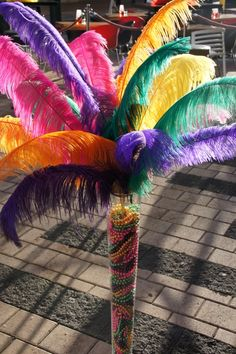 Oversized Carnival Feathers & Beads in tall vase for a Carnival Themed Event - by Creative Collective
