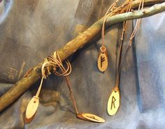 Individual rune pendants are carefully crafted on a variety of wood and hung on uncoated cotton cord (that is adjustable in length) and sealed with a handmade blend of all natural oils and waxes that are skin safe. A full range of Elder Futhark runes are available, a full Elder Futhark rune pendant sets can be also yours!