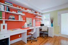 Open white shelves and desks add to the impact of orange in the home office