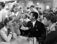 (Shirley Temple) and Richard Nugent (Cary Grant) in an ice cream parlor.