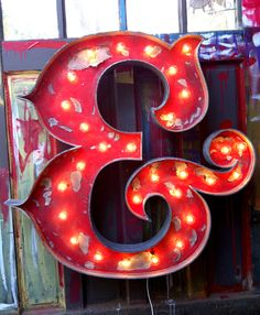 Electric AmpersandSometimes you spot something you can't help but stop and gawp at.This vintage looking ampersand was made by Tom Toupin, Coffee shop owner and carpentry enthusiast, in Providence, RI.After searching in vain for vintage 'W' and 'E' signs for his shop, White Electric, Tom decided to make his own. The final results were so successful he now makes letters to order. Though the signs look metal they are made of wood that's been sprayed with metallic paint and roughed up.You can…