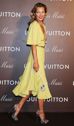 Happy 40th Birthday, Kate Moss! Let's Celebrate With a Fashion-Filled Guessing Game -Always a vision in yellow. She just looks flawless in this lemon-hued and studded Louis Vuitton dress.