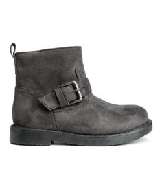 Biker boots in imitation suede. Adjustable tab and metal buckle, zip and Velcro tab at side, and rubber soles. Heel height 3/4 in.