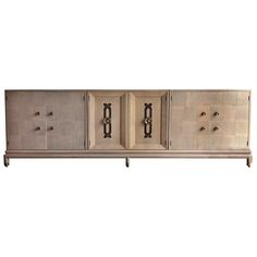 Hollywood Regency Renzo Rutili Sideboard Credenza Buffet / Baughman & Parzinger | From a unique collection of antique and modern sideboards at https://www.1stdibs.com/furniture/storage-case-pieces/sideboards/