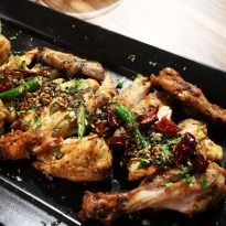 Achari Murg: Lip smacking roasted chicken cooked till brown with chillies and methi.