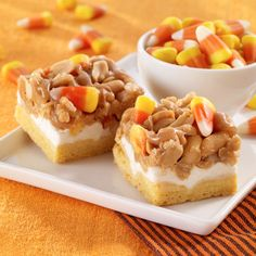 Scarecrow Treats--yellow cake crust, marshmallow middle, and a peanut butter, peanut, and candy corn topping. Look like an easy and fun fall dessert!