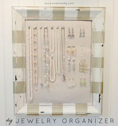 DIY Jewelry Organizer... striped picture frame and nails with decorative heads. Fab.U.Lous.