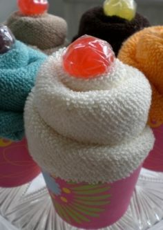 Cupcakes made from wash cloths! Cute gift idea for a bridal shower, or use baby wash clothes to add to a diaper cake display for a baby shower.