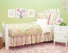 Spring Paisley Bedding Collection by Doodlefish. $510.00. Usually ships in 2-4 weeksFlowers will be in bloom all year long with this Spring Paisley Bedding Set from Doodlefish in your little girl's room! Bright pinks, greens, blues and yellows come together in paisley and stripe patterns to add color and whimsy to your kid's room. Choose your duvet size, and then add on the bed skirt, window valances, various pillow shams, and decorative pillows to complete your girl'...
