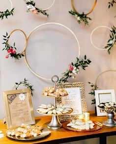 Ashley and her family cooked up a homemade dessert table! Ashley learned her beloved grandmother's recipes so that it would feel like she was there with them at the wedding. The desserts were displayed beautifully alongside framed handwritten receipies and a backdrop of whimsical floral hoops by @belovely_design. . . . . . #weddingdecor #weddinginspiration #desserttable #weddingdetails #fineartweddingphotographer #emilywrenphotography