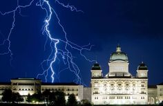 Lightning illuminates the sky during a thunderstorm over the Swiss Federal Palace in Bern July 17, 2... - MICHAEL BUHOLZER/Newscom/Reuters