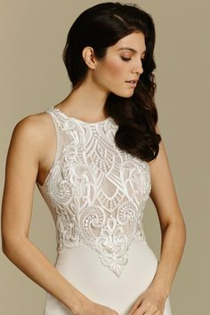 crepe sheath bridal gown, Venise lace bodice with jeweled neckline front and back and chapel train. Available Spring 2016