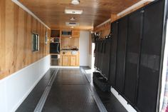 Perfect!! How to convert your enclosed trailer! Motorcycle rails, kitchen at the back, completely fold away bed platform and benches. Just need a swag to roll out on that platform - looks perfect!