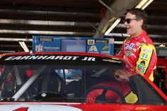 Jeff Gordon Photos - Jeff Gordon, driver of the #88 Axalta Chevrolet, climbs into his car during practice for the NASCAR Sprint Cup Series Cheez-It 355 at Watkins Glen International on August 5, 2016 in Watkins Glen, New York. - Watkins Glen International - Day 2