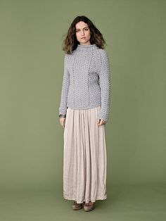A luscious, sweater with interesting fitting lines through the cables.   Ravelry: Angela pattern by Vibe Ulrik Sondergaard
