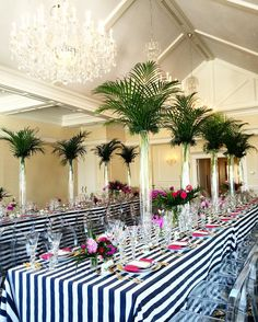 Inexpensive tall centerpiece idea. Large foliage.