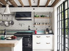 Renovation: a Manhattan townhouse gutted and reimagined for family life: In the kitchen, the soapstone island bench and marble butcher's block are by BW Architects.