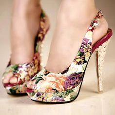 Thoroughly gorgeous floral patterned peep toe platform stilettos.