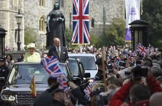 Britain's Queen Elizabeth and Prince Philip are driven past well-wishers during celebrations for the Queen's 90th birthday, in Windsor, Britain April 21, 2016. (Toby Melville/Reuters)