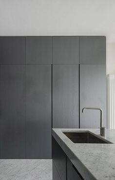 #architecture #design #interiors #kitchen #style #minimalism - FABIO CANDIDO, MARCO SARRI, MASSIMO FIORIDO | Apartment in Pisa. Marble bench. Under mount sink. Charcoal wall cabinets.