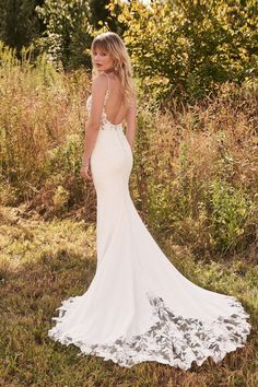 Femininity is alive with this crepe fit and flare bridal dress. With subtle exposed boning, the sexy illusion bodice features a modern scoop neckline, beaded spaghetti straps, and a seductively low scoop back. Beaded botanical appliqués cover the bodice and cascade onto the skirt before finishing with a gorgeous chapel length cutout train. Top Wedding Dresses, Wedding Dress Pictures, Wedding Dress Trends, Perfect Wedding Dress, Wedding Dress Shopping, Bridal Dresses, Dream Wedding, Prom Dresses, Lillian West Wedding Gowns
