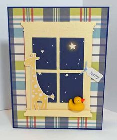 Use starry night paper behind this window die cut for a one-of-a-kind handmade baby card. The giraffe has been stamped, while the yellow rubber ducky is a 3-d embellishment.