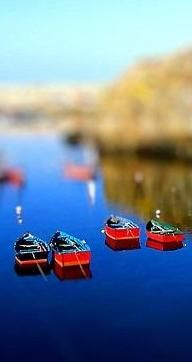 Fishing boats in Asturias, Spain can look like miniature figurines with tilt-shift photography.