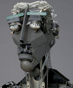 Robot Head Sculpture Industrial. Cool eyes and eyebrows!! Super awesome!Made with no solder, no glue, no welds, no wire; his process is entirely cold assembly. typewriter parts used by Jeremy Mayer.