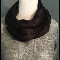 Black shimmery scarf Long black scarf with gold threads that shimmer in the light.  Can also be used as a shawl. Silver shirt also available! :) Accessories Scarves & Wraps