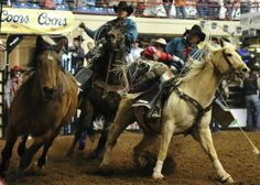 Ryan Gray looks to pick up riders Josh Edwards and Dalton Ward to exit his horse after completing a bareback riding event at the 81st San Angelo Rodeo.