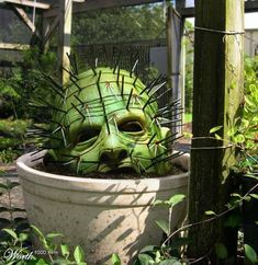 Creepy garden. This would be easy to do with doll heads, toothpicks, and green…