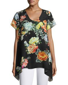 I'm not generally of fan of large florals patterrns in clothing.  The fact that the pattern here is grounded in black makes it much more appealing.  The neckline and sleeve length are perfect.  I'd style it with a pair of black capri leggings and a bright flat. ...perfect for running erands when I don't want to look as if I just rolled out of bed.  Ziara+Printed+Handkerchief-Hem+Tunic,+Black+++by+Johnny+Was+at+Neiman+Marcus.
