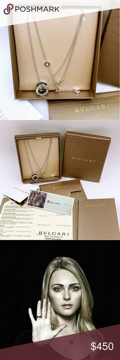 Authentic Bvlgari Save The Children Necklace Fashioned in sterling silver, the beautifully structured design is finished with a black ceramic ring and Save the Children logo. Brand new and authentic. Got a couple years ago when I was pregnant. The necklace is dainty and elegant. It matches anything. What is most important is that part of every purchase goes to save the children organization donation. Let's spread the love. Bulgari Jewelry Necklaces