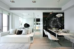 Modern living and dining room in black and white