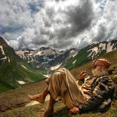"Relaxing after minding the sheep!  ""A Shepherd in Northern Pakistan."""