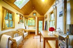 This cheerful little tiny house is currently a vacation rental located just outside of Olympia Washington. The home measures 160 sq ft. In addition to the usual home amenities it also features a cozy window seat a skylight in the loft bedroom and a small porch. It's nestled in a forest with access to a fire pit and is just a short walk to a private beach.    #dreambiglivetiny #tinyhome #tinyhousemovement #tinyliving #tinyhouse #tinyhousenation #tinylifestyle #compactliving #smallhomes…