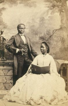 """At the age of five, Sarah Forbes Bonetta Davies, born into a royal Yoruba dynasty, was taken to England and presented to Queen Victoria as a """"gift"""" from one royal family to another. A unique and admired figure in history, she spent her life between the British royal household and her homeland in Africa."""