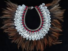 Beauty Shell Necklace with Beads and feather by ubudexotica