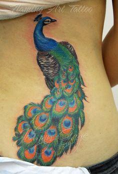 peacock tattoo by johnny gage, via Flickr                              pretty on a wrist?