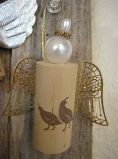 wine cork angels are so pretty to look at.  other fun ways to use wine corks -- in drawers to stick pins and safety pins.  i love the angels!
