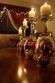 Upside down wine glass topped with a tea candle makes for a fantastic centerpiece.