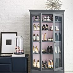 This makes me laugh.  I would never do the shoes but pretty cute!  old hutch or curio cabinet... painted... display prettiest shoes
